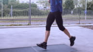SLO MO TS Male runner running in a city video