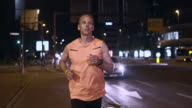 SLO MO TS Male runner running in city at night video