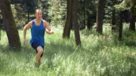 SLO MO DS Male runner running in forest video