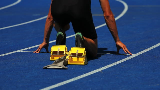 HD Male Runner Sprinting Off Starting Block video