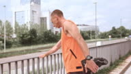 LD Male runner stretching his legs in the city video