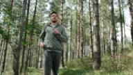 Male runner taking a breath video