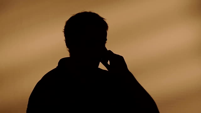 Male silhouette calling on the phone video