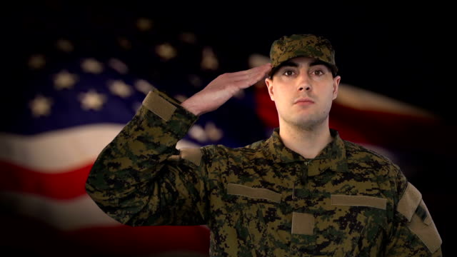 Male Soldier Salute with US Flag Background video