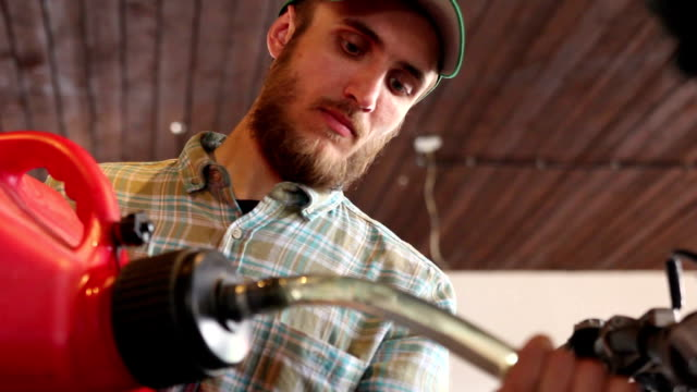 male sportsman fills his enduro motorcycle with gasoline video