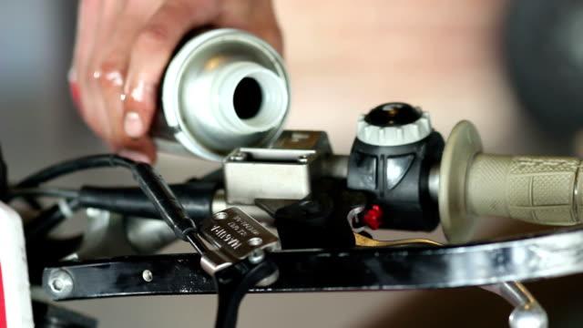 male sportsman repairing his enduro motorcycle video