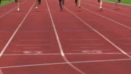 SLO MO Male Sprinters At The Finish Line video
