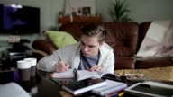 A male student concentrates on study . video
