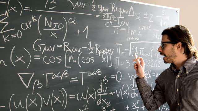 Male teacher explaning Mathematics video