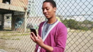 Male Teenager talking on mobile phone video