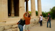 Male tourist taking picture of ancient building on smartphone, vacation video