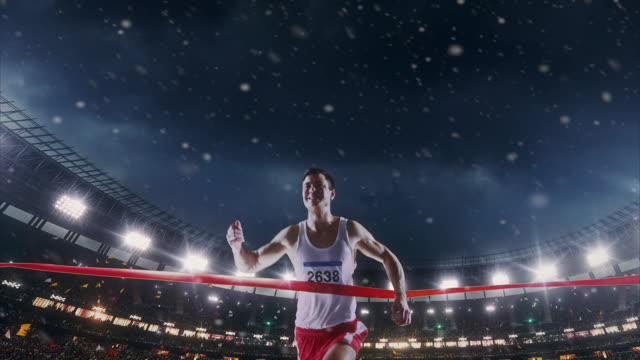 Male track and field runner crosses finishing line video