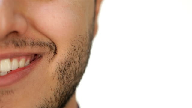 Male unshaven face and smile video