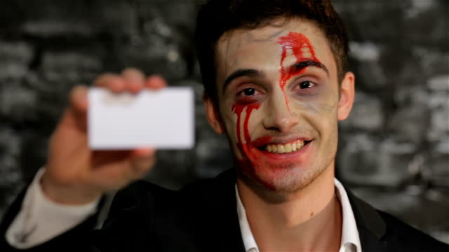 Male vampire gives you a business card video