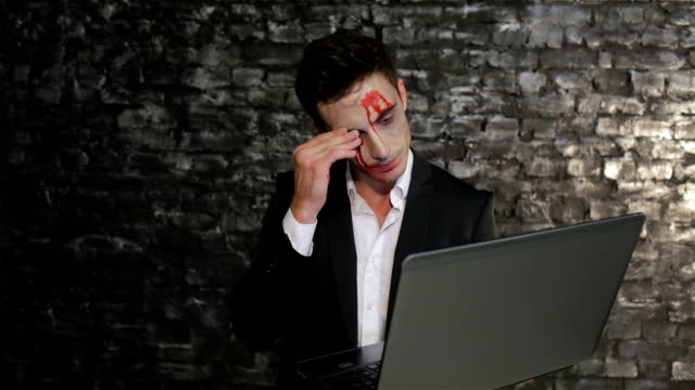 Male vampire uses the laptop video