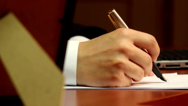 Male worker making notes, handwriting, businessman at work video