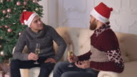 Males enjoy conversation in apartment video