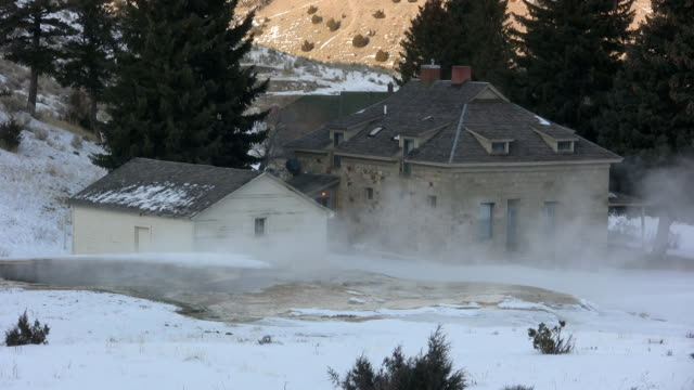 mammoth hot spring yellowstone with building in background. video