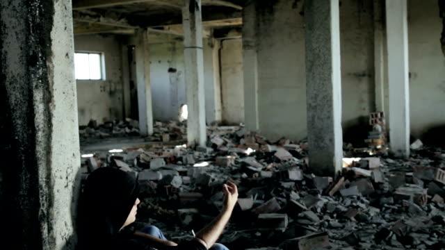 Man Abusing Drugs in Abandoned Building Smoke Crane Shot HD video