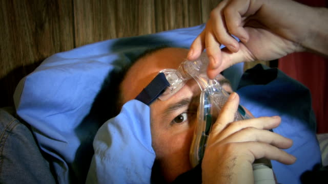 Man adjusting CPAP mask before bed video