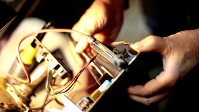 Man adjusts an electronic object video