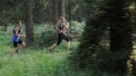 SLO MO DS Man and a woman running a trail marathon video