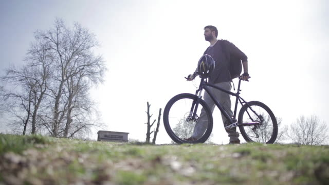Man and Bicycle on Nature Background video