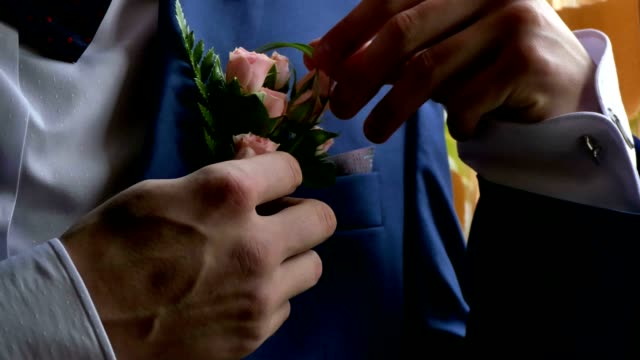 man and boutonniere video