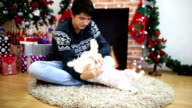 Man and his dog in front of a Christmas tree. video