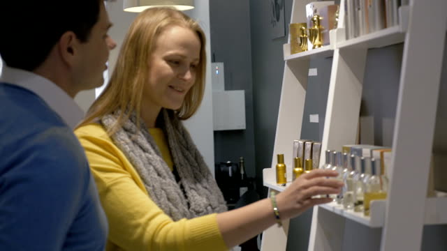 Man and Woman by the Shelf with Perfumery video