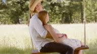 SLO MO TU Man and woman cuddling on a swing video