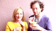 Man and woman drinking healthy smoothie video