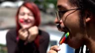 Man And Woman Eating Lollipops video