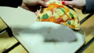 Man and woman fighting for the last piece of pizza. video