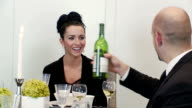 Man and woman have wine at dinner party video