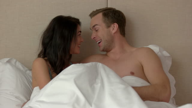 Man and woman in bed. video