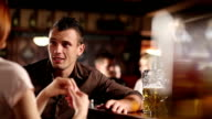 Man and woman in the Pub video