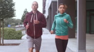 SLO MO TS Man and woman jogging in the city video