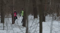 Man and woman practicing winter cross-country running video