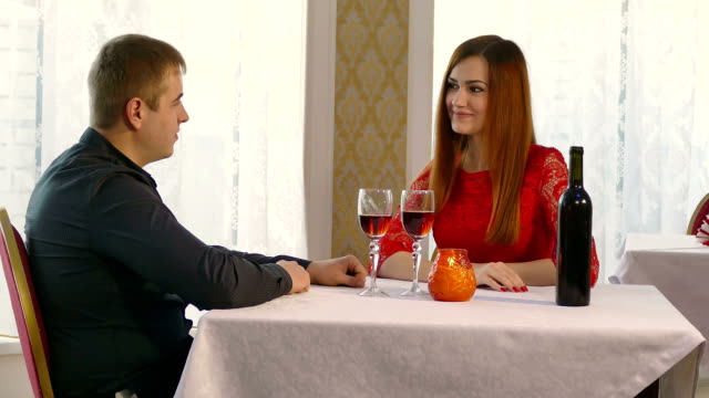 man and woman romantic evening in restaurant drinking wine, vide video