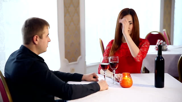 man and woman romantic evening love in a restaurant drinking wine, Valentine's Day video