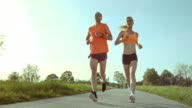 SLO MO TS Man and woman running on a sunny day video
