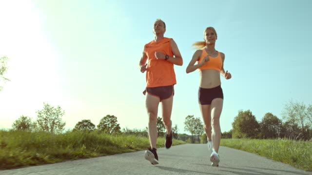 SLO MO TS Man and woman running video