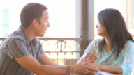 Man and woman sit talking video