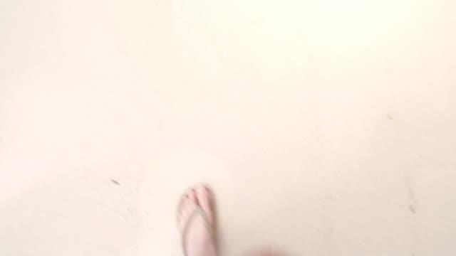 Man and woman walking at beach video