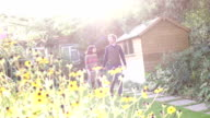 Man and woman walking in Garden, Lens flare, Slow motion video