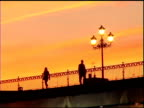 Man and Woman walking on Bridge in Seville video