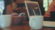 Man and woman work in cafe using gadgets video