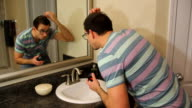 Man Applying Hair Product video