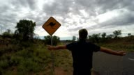 Man arms outstretched in Australia video